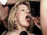 Blonde mature gets facial in group