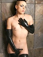 Sexy babe Pia showers in black latex