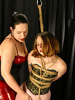 Helpless Regina struggles - but not very hard - against mistress Bridgett's dominating demands